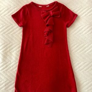 Red sparkly holiday dress with bow and ruffles